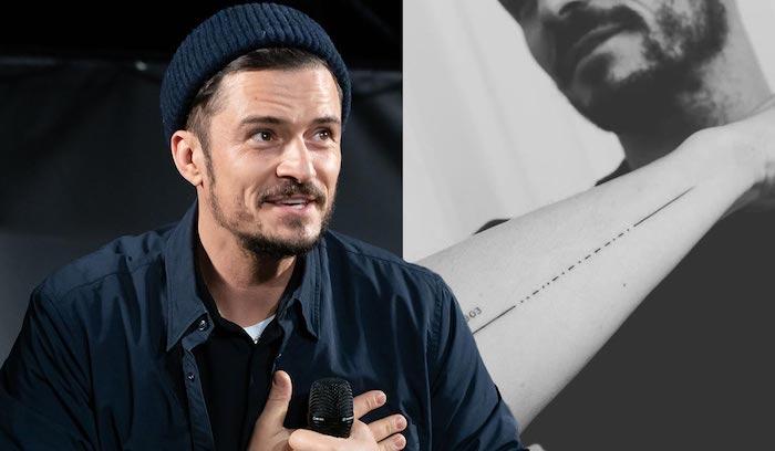 ein mann mit blauem hut und bart, das tattoo des schauspielers orlando bloom mit den namen seines sohns flynn, tattoo mit morsecode, ein fehler im tattoo
