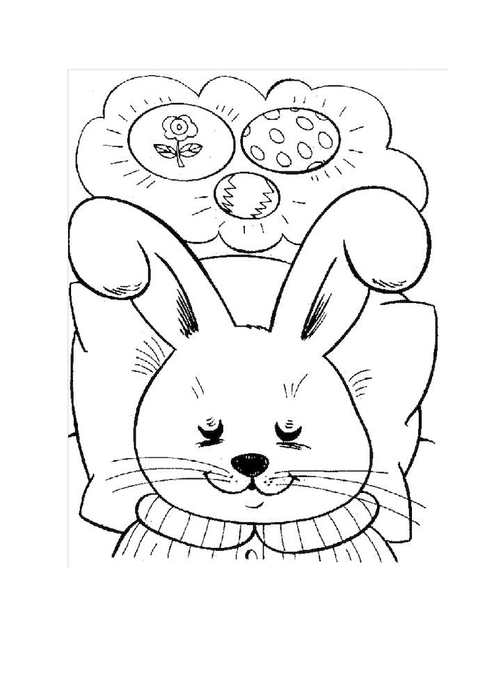 Osterhase im Bett träumt von Osterhasen, lustiges Ausmalbild für Kinder für Ostern