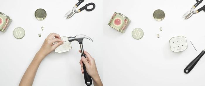 Hand löchert Löche in die Dose mit einem Hammer, Pflanzer aus Teedosen selbst basteln, pinterest garten, upcycling ideen garten
