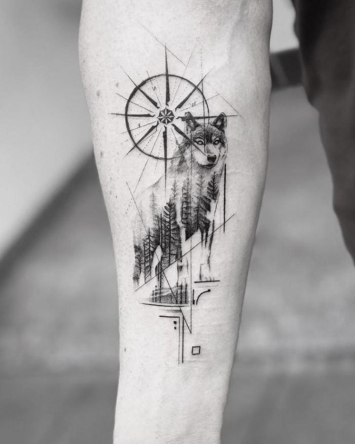 unterarm tattoo mann, wolf mit kompass und geometrischen elementen, blackwork