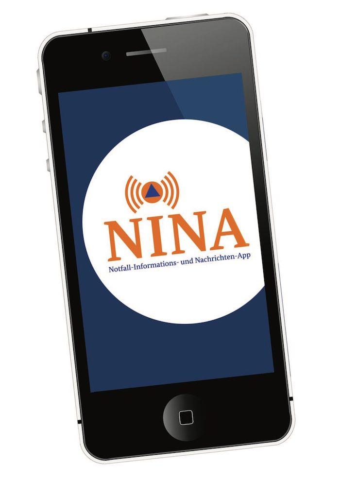 die kostenlose app nina warnt vor voronavirus , ein schwarzes handy mit einem blauen bildschirm und der app nina
