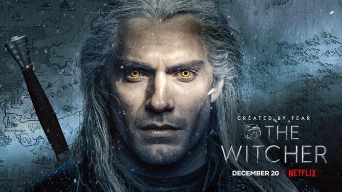 mann mit orangen augen und langem weißen haar und einem schwert, the witcher von netflix