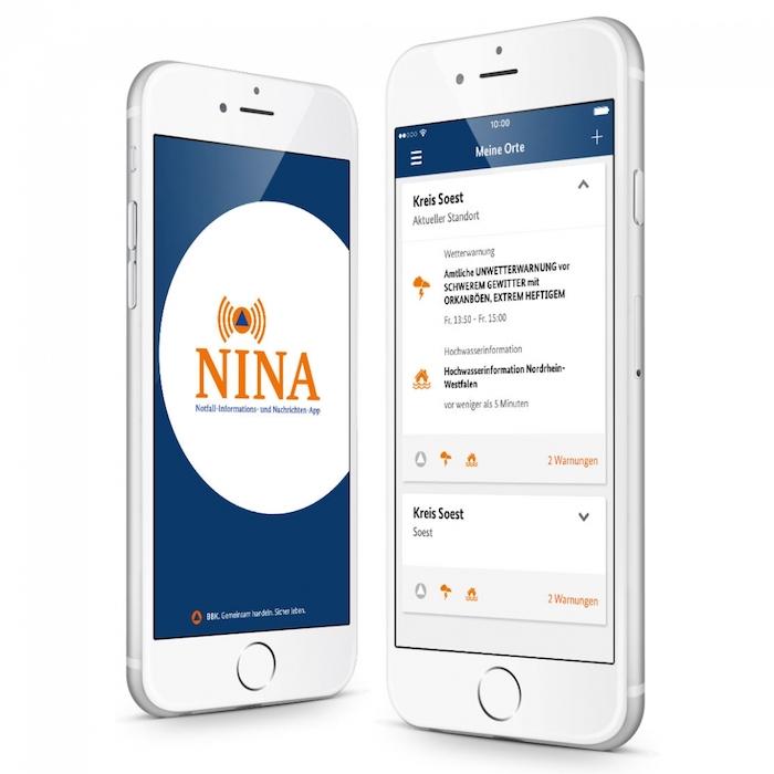 ein smartphone mit der kostenlosen anwendung nina, die vor ausbrüche des aktuellen coronavirus warnen