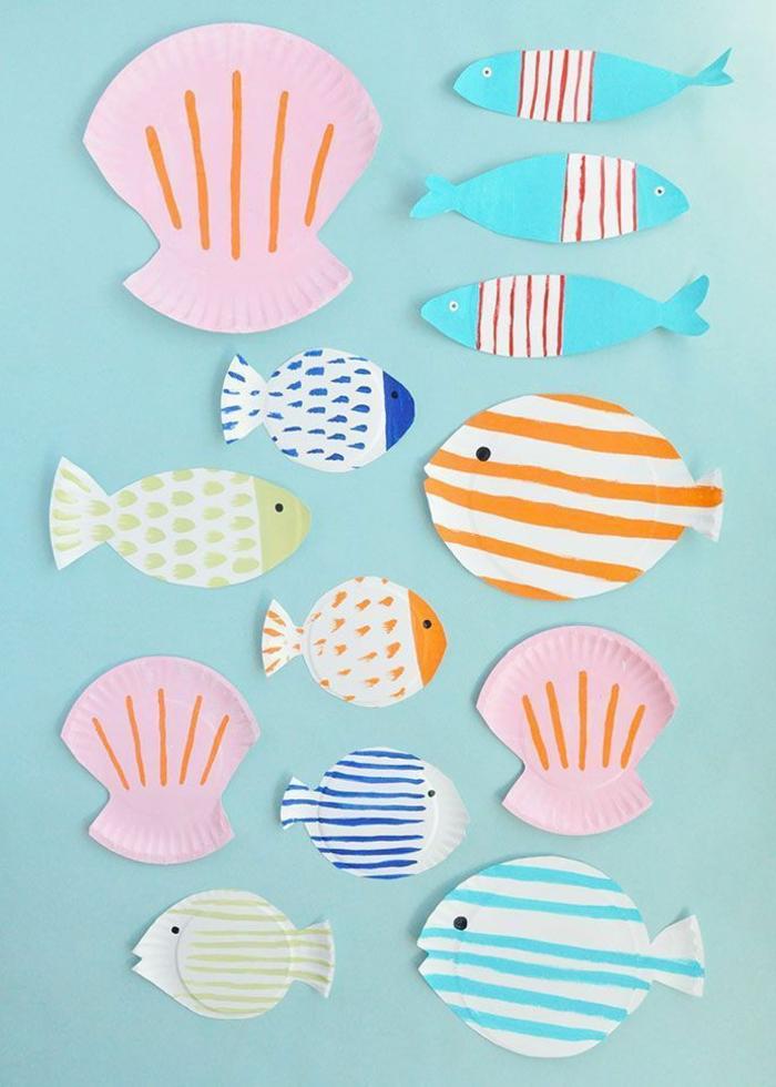 kleine und große bunt bemalte Fische, pinke Muscheln, Aquarium basteln, DIY Anleitung