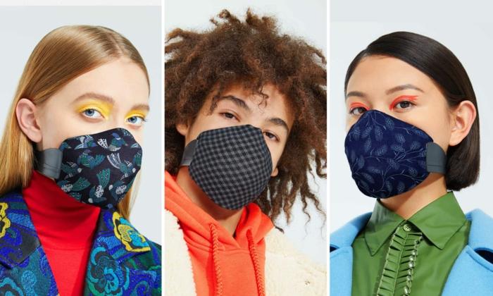Drei Frauen tragen verschiedene Arten von Masken, angezogen in bunten Farben, Schutz vor Coronavirus