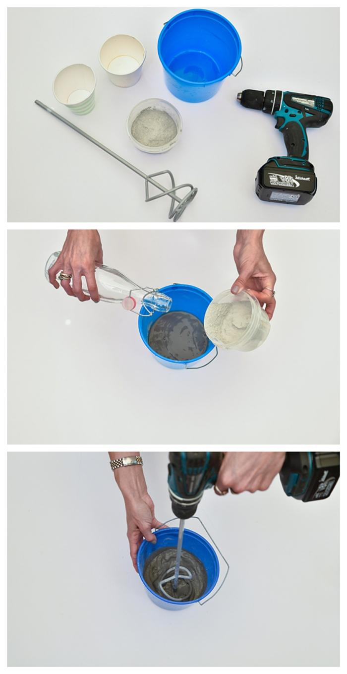 Hand mischt Beton mit Wasser in einem blauen Eimer, DIY Betonkübel für Pflanzen, Anleitung Schritt für Schritt