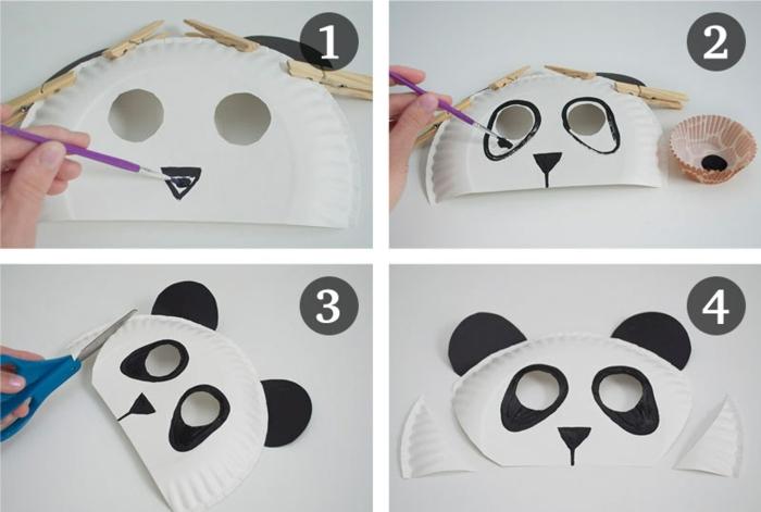 DIY Anleitung, Wie kann man sich Panda Masken basteln, Hand malt schwarze Nase auf weiße Maske