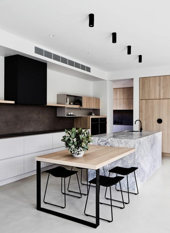 Küche mit Kochinsel mit integriertem Esstisch, schlichte und minimalistische Gestaltung in weiße und schwarze Farben