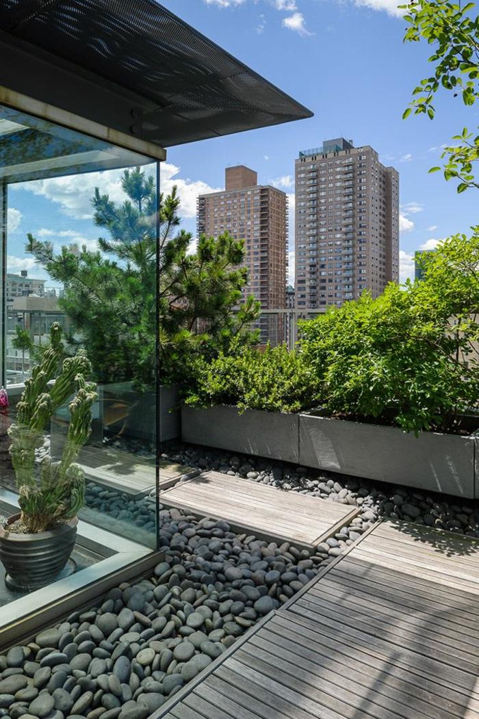 steingarten bilder dachgärten mit kiselsteinen grüne pflanze und bäume außeneinrichtung ideen