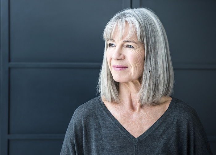 senior woman with gray hair looking away