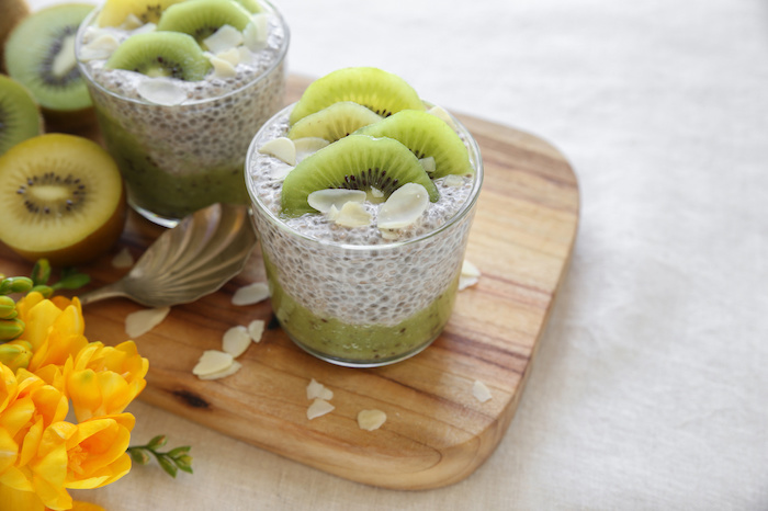 homemade chia pudding with kiwi and almond slices, easter breakfast idea