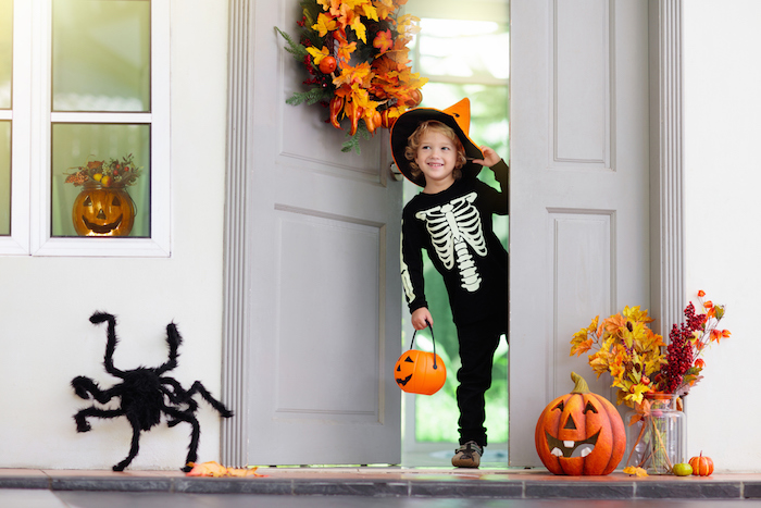 kids trick or treat. halloween. child at door.