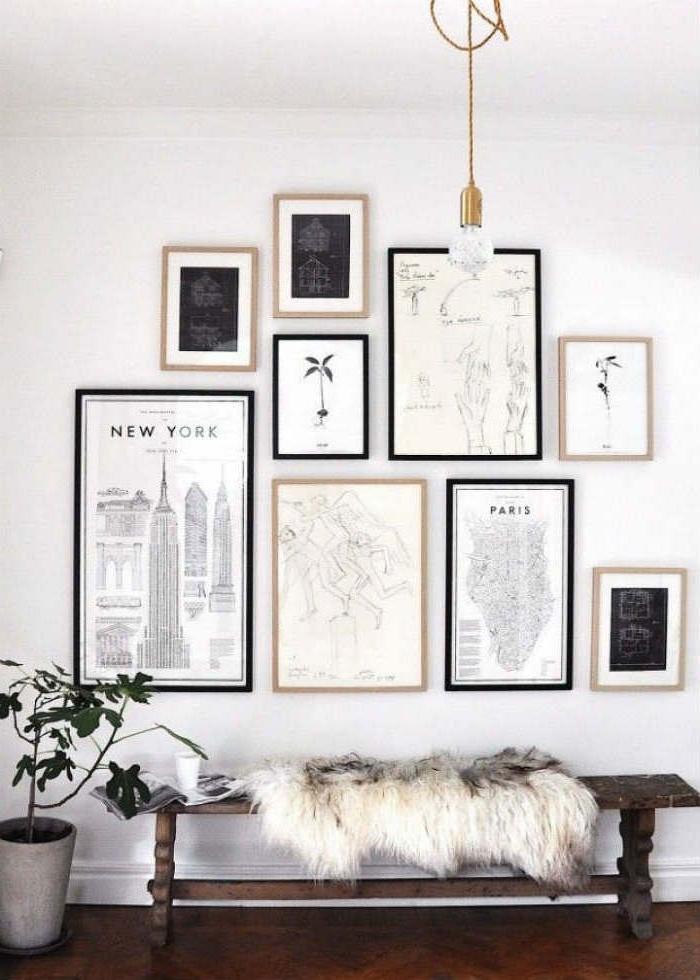 dunkle holzbank weiße flauschige decke wanddeko wohnzimmer modern bilder new york karte von paris moderne linienzeichnungen minimalistische innenausstattung inspiration holzboden