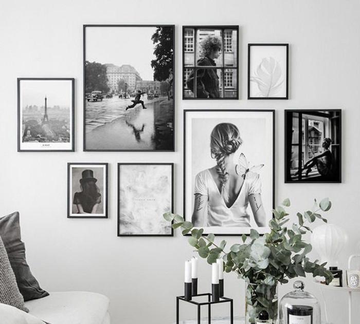 schöne schwarz weiße fotografien wohnzimmer wand ideen kleine und große fotos fotowand gestalten einrichtung wohnzimmer ideen und inspiration grüne zweige weiße kerzen minimalistisches design
