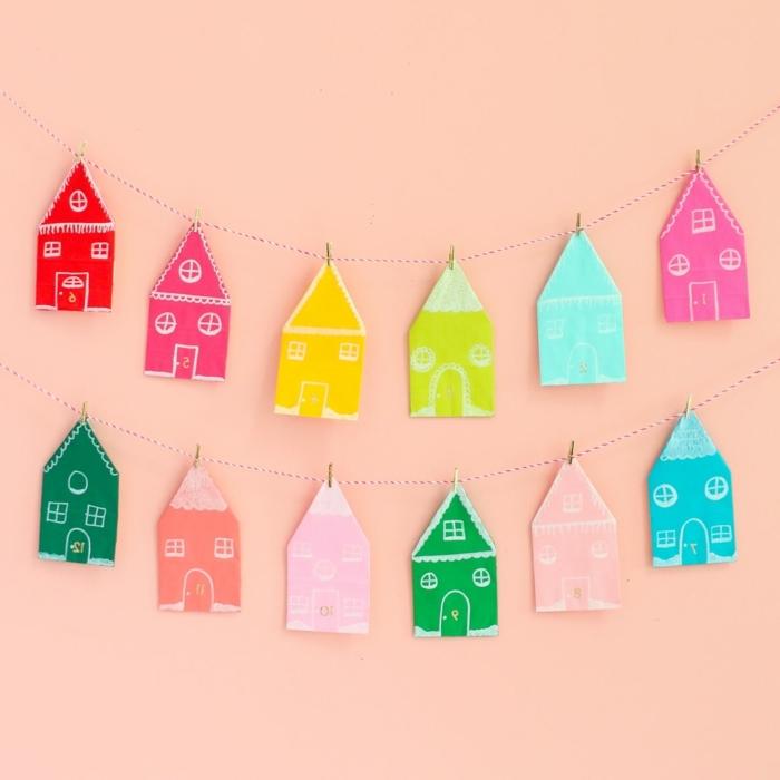 0 weihnachten basteln mit kindern zum advent girlande mit häuschen aus papier papierhäuschen in bunten farben wanddeko winter