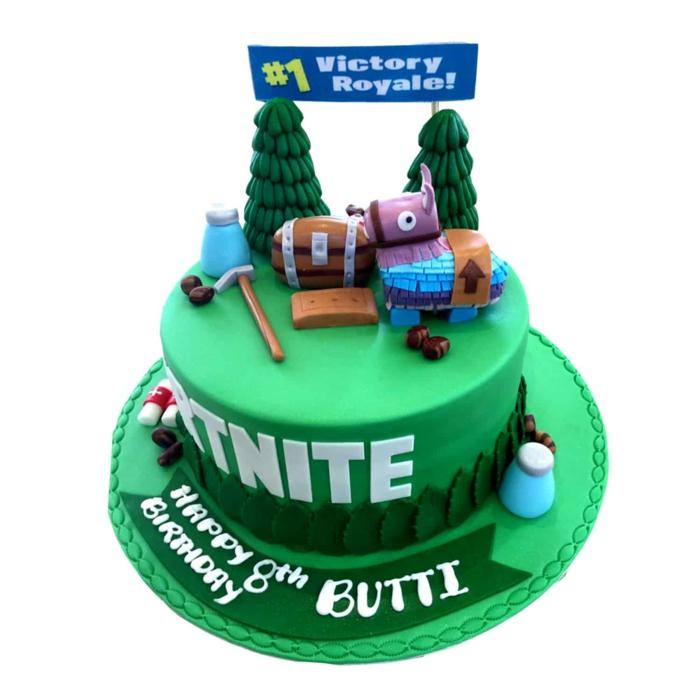 10 geburtstag party ideen und inspiration grüne torte bunte deko figuren lama truhe tannenbäume kreativer geburtstagskuchen ideen