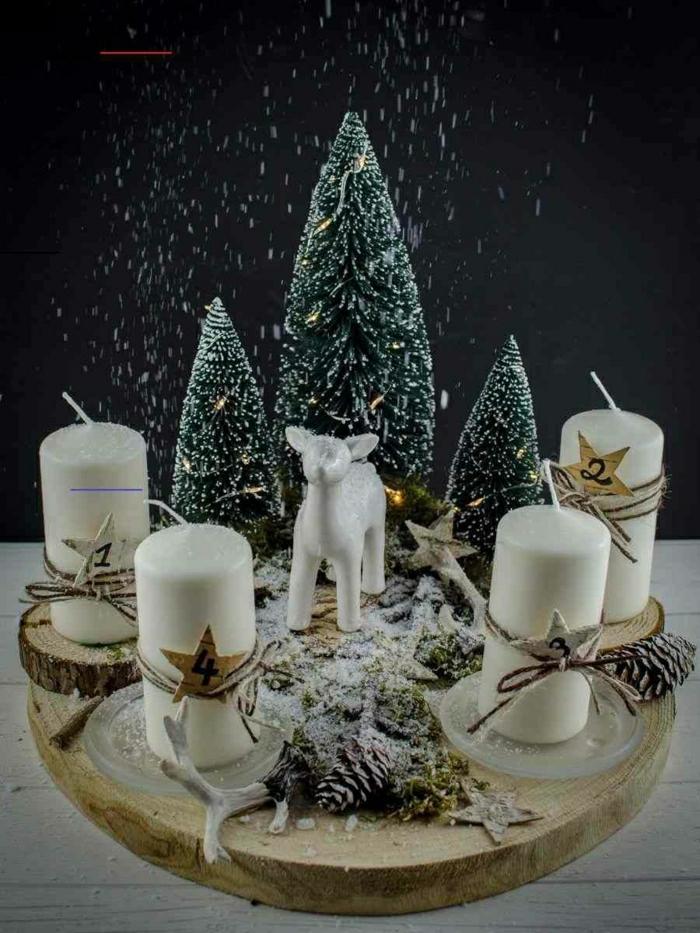 adventskranz baumscheibe diy vier kerzen weiß reh keramik weiß tannenbäume deko
