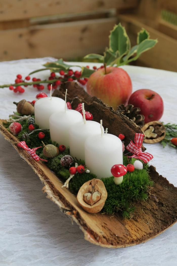 adventskranz holzscheibe ideen adventskranz modern baumrinde vier kerzen tannenzweige nüsse