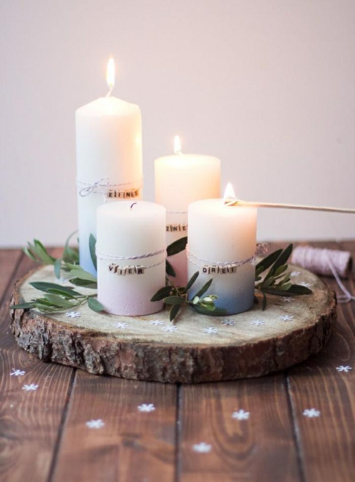 adventskranz holzscheibe selber machen baumscheibe vier kerzen weiß eukalyptuszweige anzünden