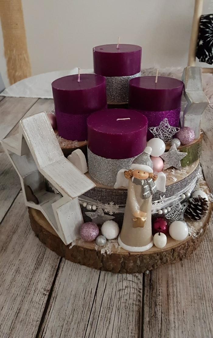 adventskranz holzscheiben selber machen kleine und große baumscheiben lila kerzen sternen engel