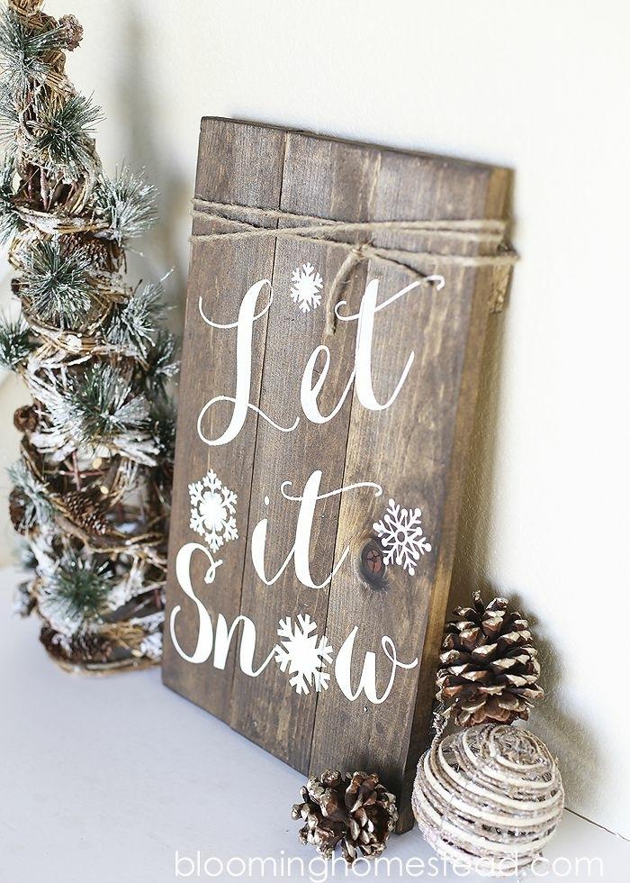 bastelideen für weihnachten holzplatte mit schriftzug selbstgemachte deko wanddeko ideen diy deko