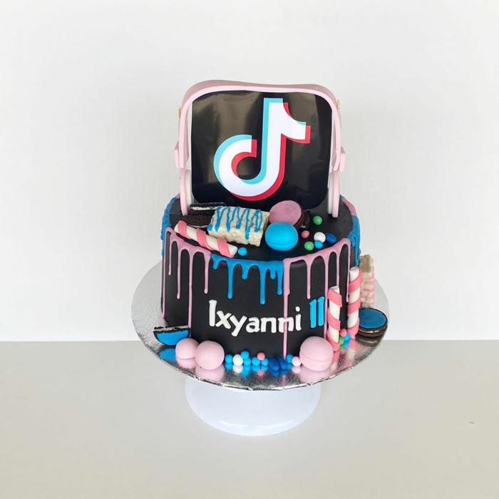 kreative fondant torte 18 geburtstag junge inspiration schwarze glasur bunte dekoration tiktok kuchen
