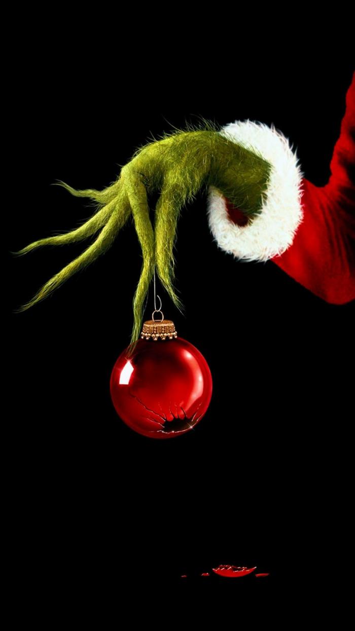 iphone bild weihnachten die schönsten hintergrundbilder wie der grinch weihnachten gestohlen hat grinch hält rote weihnachtskugel