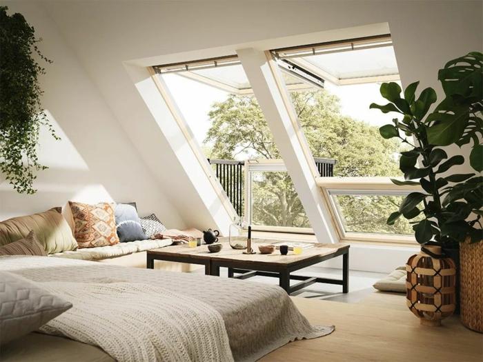 gemütliches wohnzimmer einrichtung modernes ecksofa dekorative bunte kissen großes dachfenster austauschen kosten deko grüne pflanzen