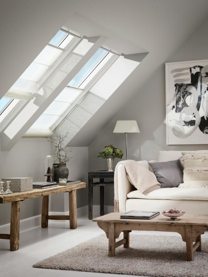 minimalistische einrichtung wohnzimmer neutrale farben beiges sofa abstraktes gemälde velux fenster einbauen tische aus holz