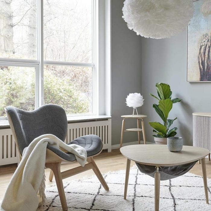 einrichtung wohnzimmer in grauen farben stuhl mit grauer polsterung runder kaffeetisch minimalistische einrichtung hygge möbel minimalistisch