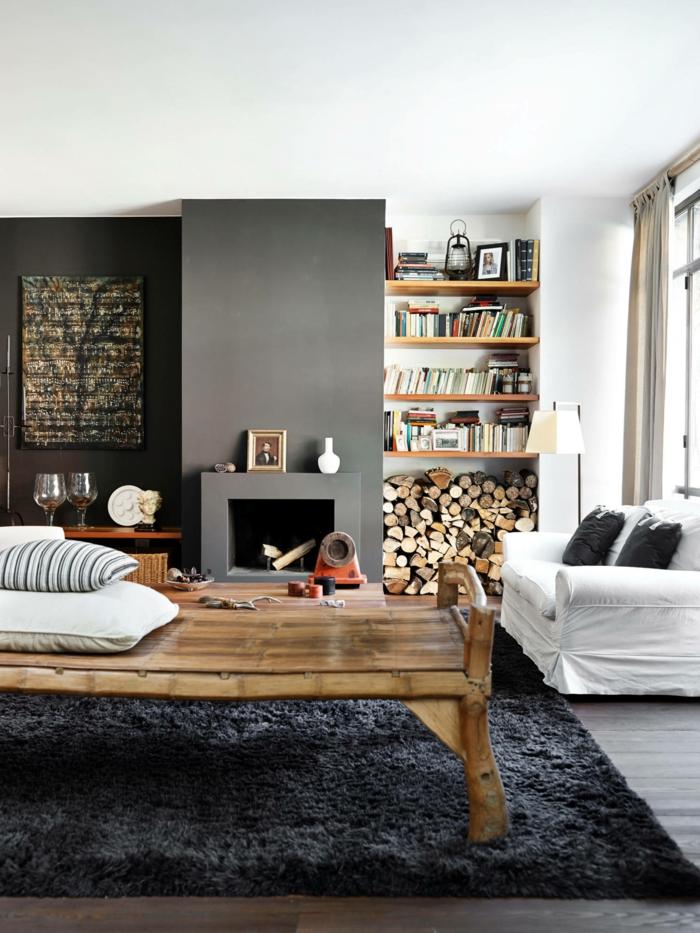 flauschiger dunkler teppich großer tisch aus holz kleines weißes sofa wohnzimmer skandinavischer stil mit kamin inneneinrichtung 2021 modern