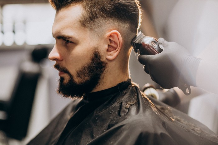 client doing hair cut at a barber shop salon