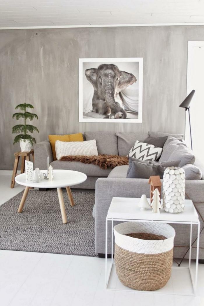 neutrale farben einrichtung graues ecksofa weißer runder kaffeetisch bild von einem elefanten an die wand scandi style wohnen