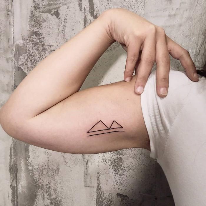 runen bedeutung runen tattoo verboten nordische mythologie tattoo runen symbole berkana tattoo arm