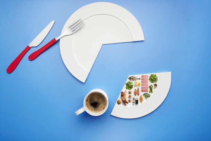 paper plate with segment cut out and lots of miniature food on the small cut segment