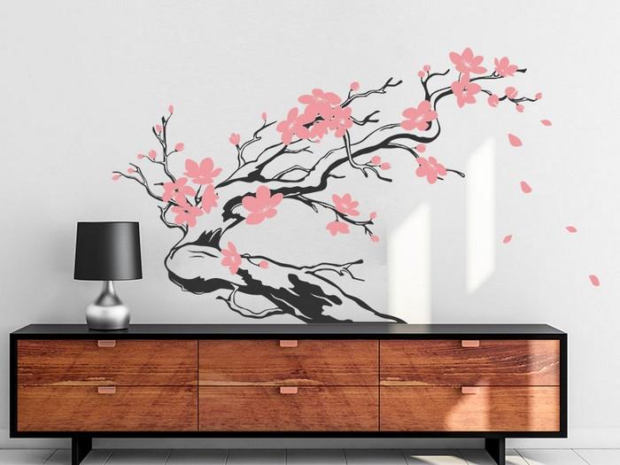 wabi sabi interior japanische einrichtung wohnzimmer japanischer stil wandtatoo mit blumen rosa standlampe schwarz schrank aus holz