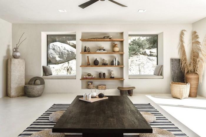 wohnzimmer japanischer stil wabi sabi wohnen wohnzimmer japanisch einrichten niedriger holztisch in schearz wandregalien weiß naturholz viele pflanzen teppich