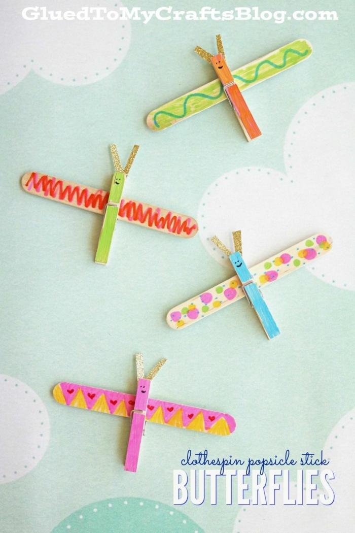 basteln mit eisstielen frühling bunte schmetterlinge gebastelt aus eisstäbchen upcycling ideen bastelideen für kinder
