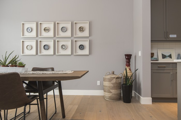 interior shot of a modern house dining room with art on the wall