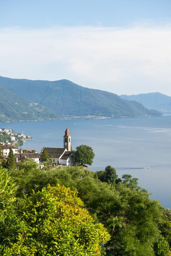 church in ronco sopra ascona on alpine lake maggiore with mountain