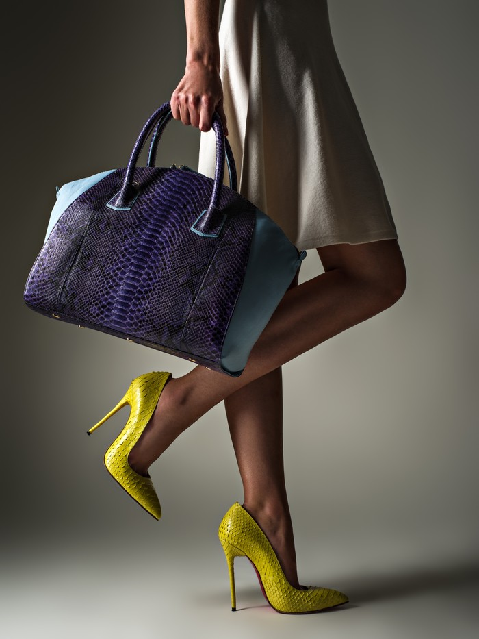 beautiful woman with a slim legs in yellow high heels. fashionab