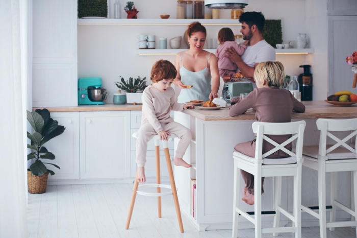 happy,family,with,three,kids,having,breakfast,at,the,kitchen