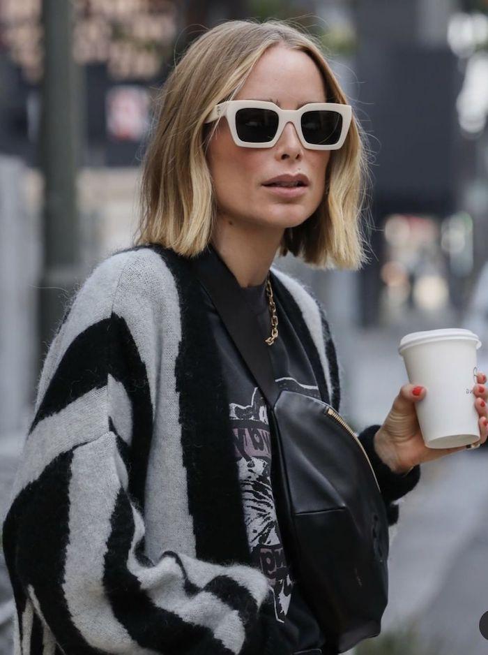 casual style street style new york schwarzes legeres outfit schwarze sonnenbrillen mit weißem rahmen frau mit blonden haaren bob dünnes haar blunt