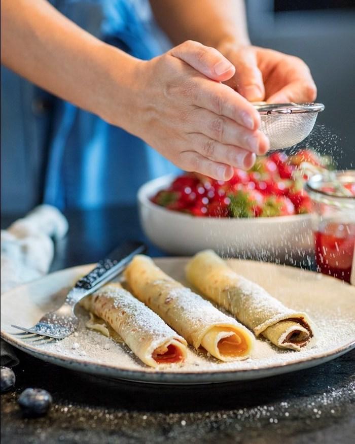 gefüllte pfannkuchen rezepte pfannkuchen füllung herzhafte pfannkuchen vegetarisch gefüllte pfannkuchen mit schokolade drei pfannkuchen mit pulverzucker bestreuen