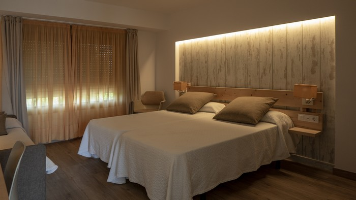 interior of a bedroom in white and creamy tones