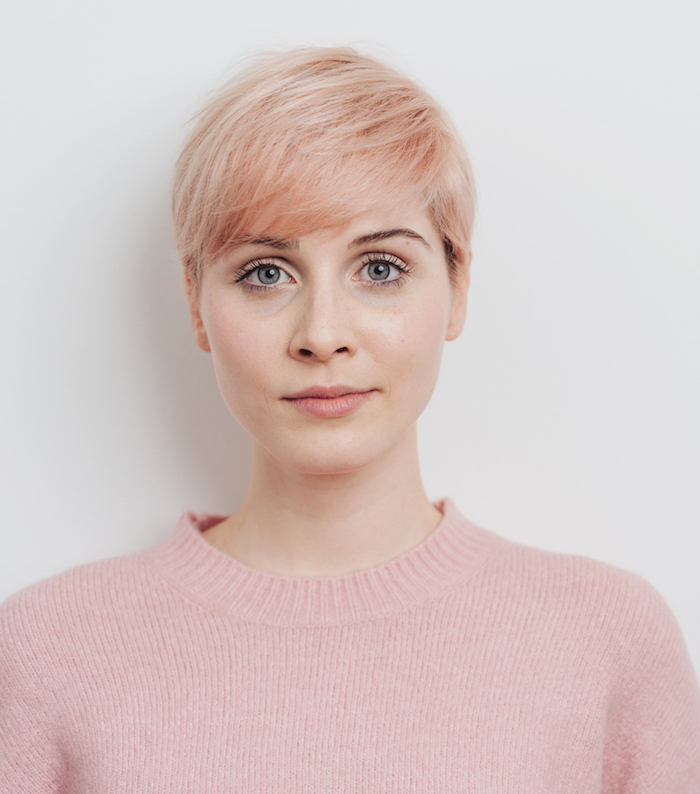 serious attractive young strawberry blond woman