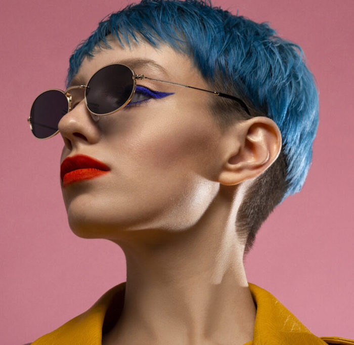 blue hair girl in sunglasses wearing yellow jacket