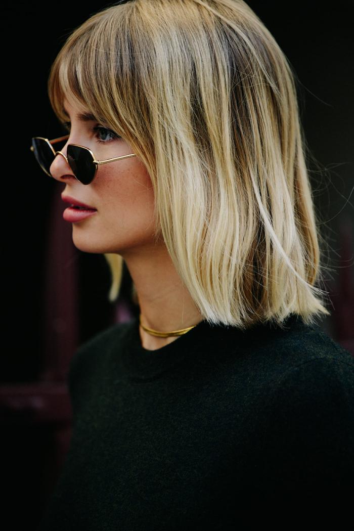 xenia adonts street style kleine schwarze sonnenbrillen kurze blonde haare mit pony frisur schwarzes outfit
