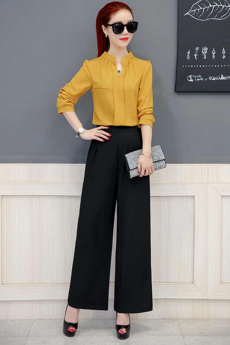 hose wide leg wide leg jeans kombinieren frau mit schwarzen wide leg hosen gelbe bluse rote haare