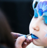 portrait of little girl during the face painting session